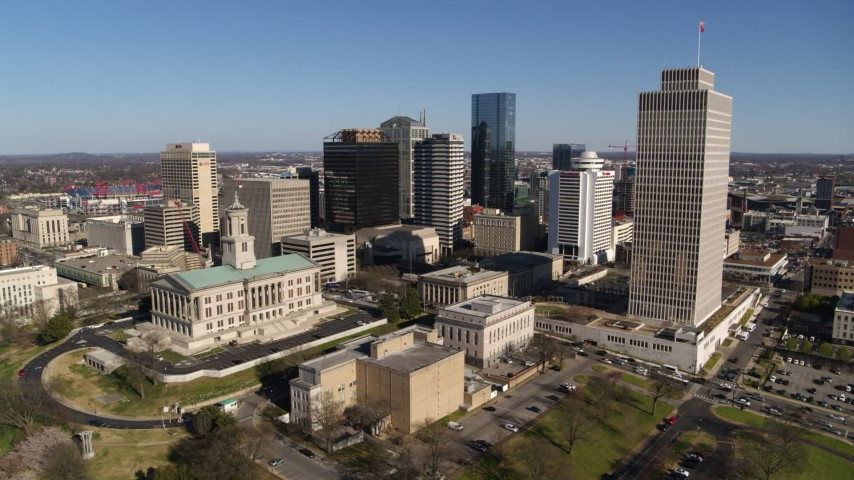 5.7K stock footage aerial video approach Tennessee State Capitol, skyscrapers, Tennessee Tower in Downtown Nashville, Tennessee Aerial Stock Footage | DX0002_114_008