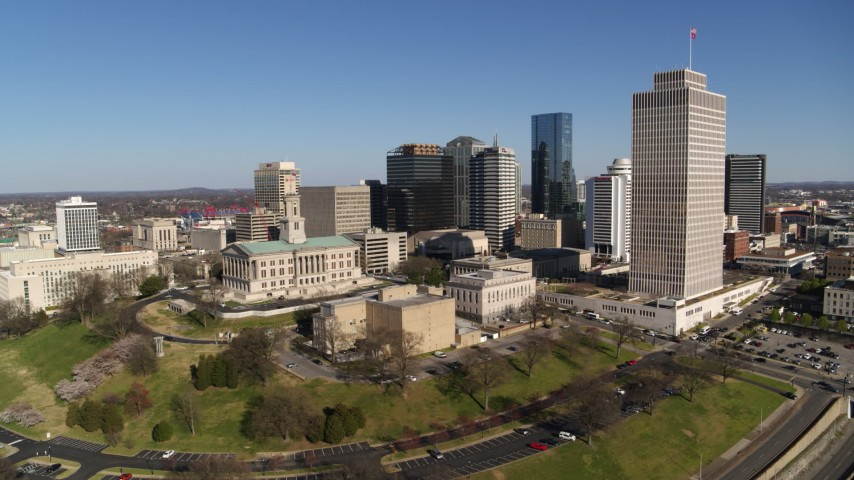 5.7K stock footage aerial video descend and orbit Tennessee State Capitol, skyscrapers, Tennessee Tower in Downtown Nashville, Tennessee Aerial Stock Footage | DX0002_114_009