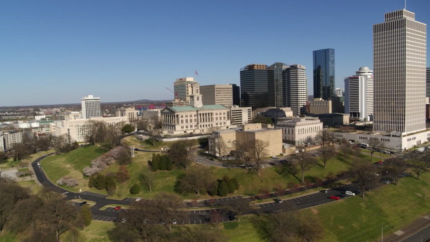 5.7K stock footage aerial video circle around Tennessee State Capitol near tall skyscrapers in Downtown Nashville, Tennessee Aerial Stock Footage | DX0002_114_011