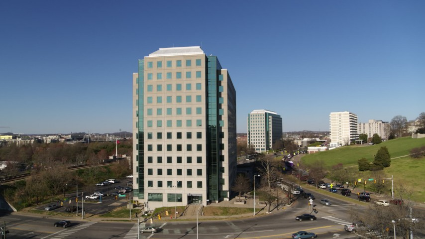 5.7K stock footage aerial video stationary view of Andrew Johnson Tower, a government office building in Downtown Nashville, Tennessee Aerial Stock Footage | DX0002_114_013