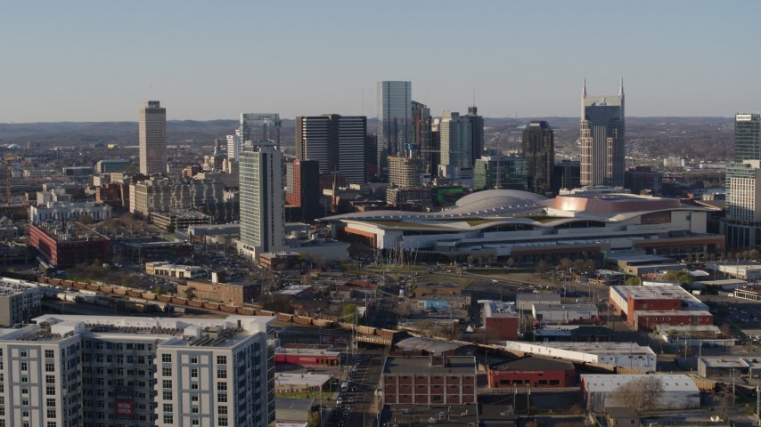 5.7K stock footage aerial video ascend for view of convention center and skyline in Downtown Nashville, Tennessee Aerial Stock Footage | DX0002_114_014