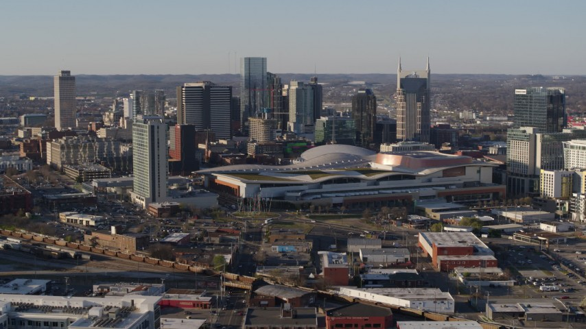 5.7K stock footage aerial video of passing by the convention center and skyline in Downtown Nashville, Tennessee Aerial Stock Footage | DX0002_114_016