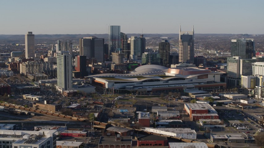 5.7K stock footage aerial video of flying by the convention center and skyline before descent in Downtown Nashville, Tennessee Aerial Stock Footage | DX0002_114_017