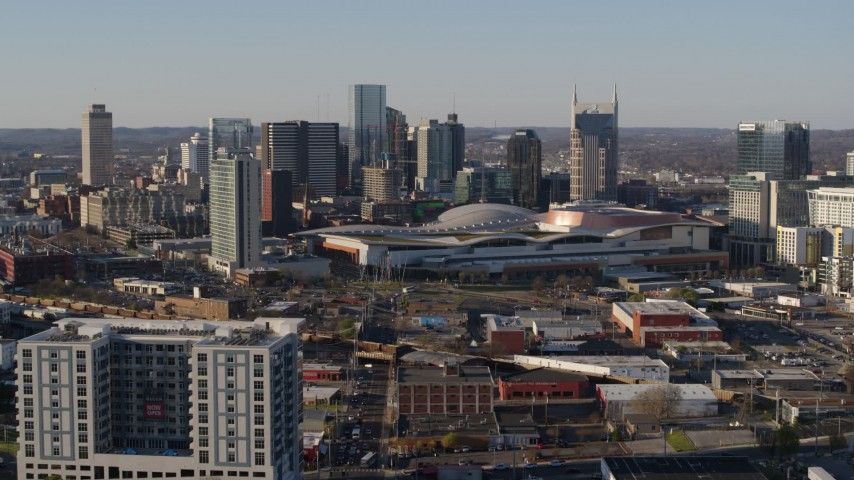 5.7K stock footage aerial video of a reverse view of the convention center and skyline in Downtown Nashville, Tennessee Aerial Stock Footage | DX0002_114_018