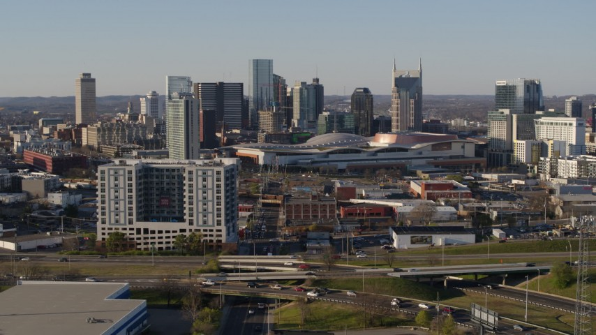 5.7K stock footage aerial video of the city skyline behind the convention center in Downtown Nashville, Tennessee Aerial Stock Footage | DX0002_114_019