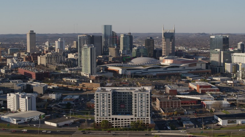 5.7K stock footage aerial video ascend and flyby the city skyline behind the convention center in Downtown Nashville, Tennessee Aerial Stock Footage | DX0002_114_020