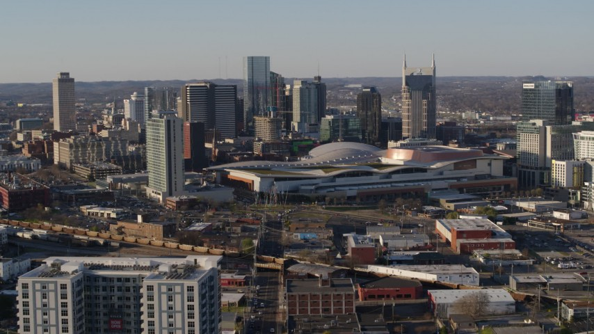 5.7K stock footage aerial video approach the city skyline behind the convention center in Downtown Nashville, Tennessee Aerial Stock Footage | DX0002_114_021