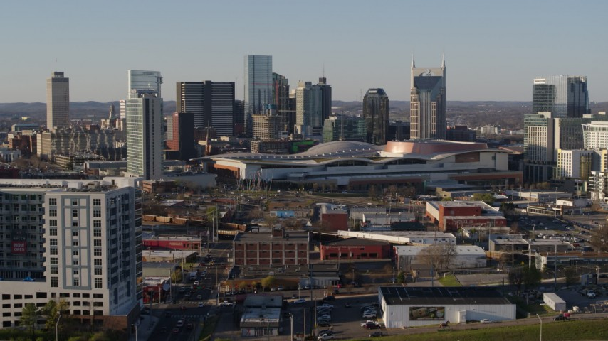 5.7K stock footage aerial video ascend over freeway toward the city skyline behind the convention center, in Downtown Nashville, Tennessee Aerial Stock Footage | DX0002_114_023