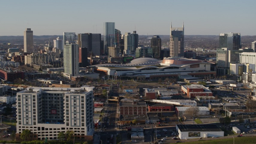 5.7K stock footage aerial video of slowly flying toward the city skyline and the convention center in Downtown Nashville, Tennessee Aerial Stock Footage DX0002_114_025