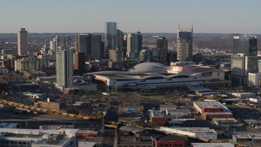 5.7K stock footage aerial video of the city skyline behind the convention center during ascent in Downtown Nashville, Tennessee Aerial Stock Footage | DX0002_114_026