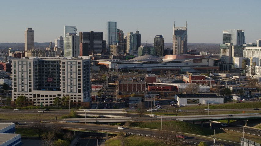 5.7K stock footage aerial video of the city skyline and convention center, reveal I-65 in Downtown Nashville, Tennessee Aerial Stock Footage | DX0002_114_027