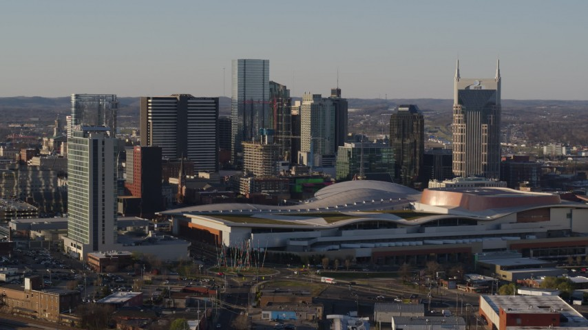 5.7K stock footage aerial video of a view of the city skyline and the convention center during ascent in Downtown Nashville, Tennessee Aerial Stock Footage | DX0002_114_028