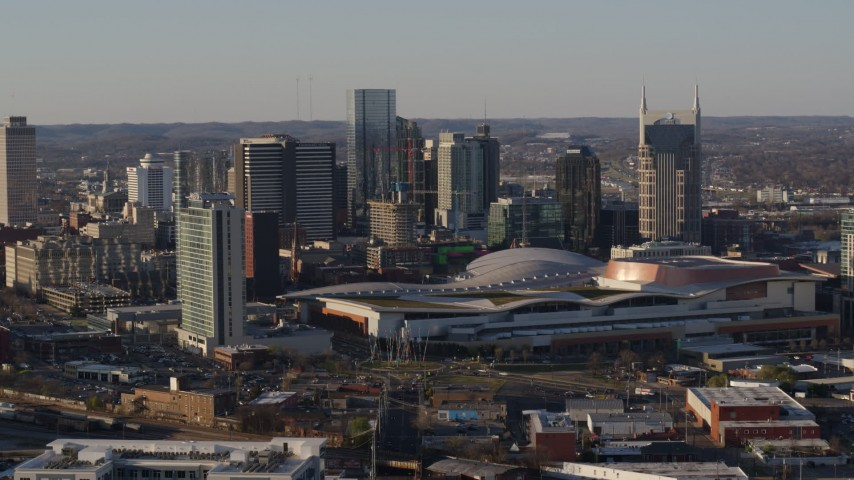 5.7K stock footage aerial video of approach and orbit the convention center and city skyline in Downtown Nashville, Tennessee Aerial Stock Footage | DX0002_114_030