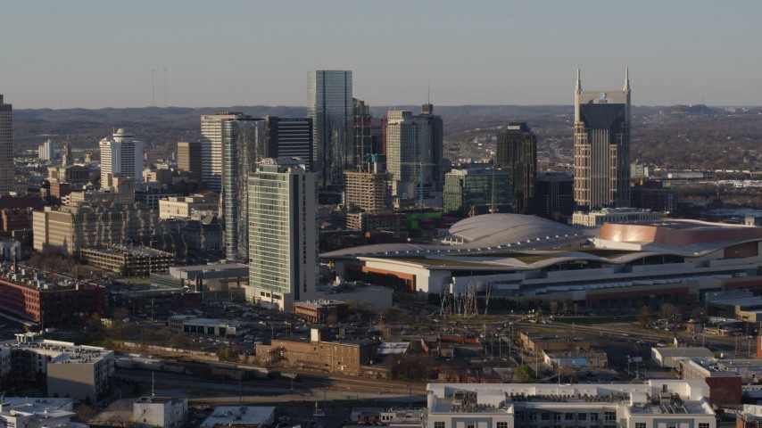 5.7K stock footage aerial video descent, and stationary view of city skyline and the convention center in Downtown Nashville, Tennessee Aerial Stock Footage | DX0002_114_031