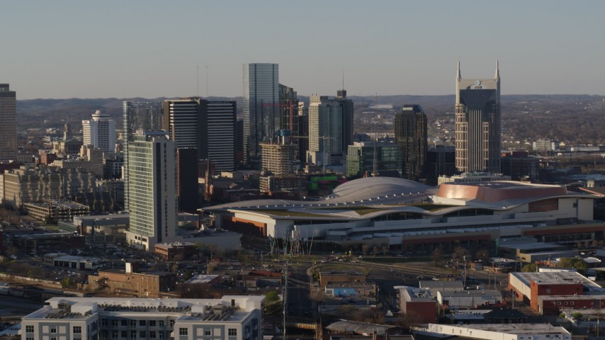 5.7K stock footage aerial video of slowly past the city skyline and the convention center in Downtown Nashville, Tennessee Aerial Stock Footage | DX0002_114_032