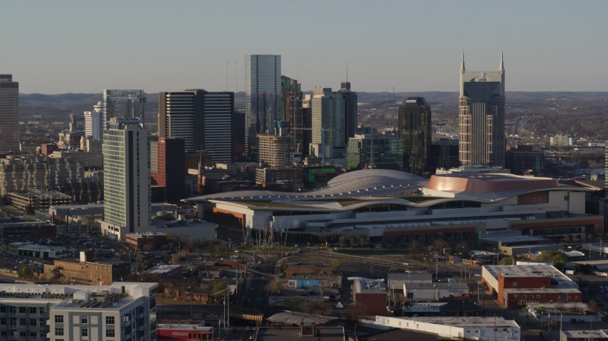 5.7K stock footage aerial video descending with view of city skyline and the convention center in Downtown Nashville, Tennessee Aerial Stock Footage | DX0002_114_033