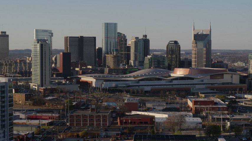 5.7K stock footage aerial video flying past city's tall skyline by the convention center in Downtown Nashville, Tennessee Aerial Stock Footage | DX0002_114_035