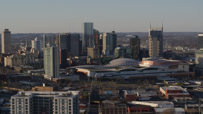 5.7K stock footage aerial video ascend away from city's tall skyline by the convention center in Downtown Nashville, Tennessee Aerial Stock Footage | DX0002_114_036