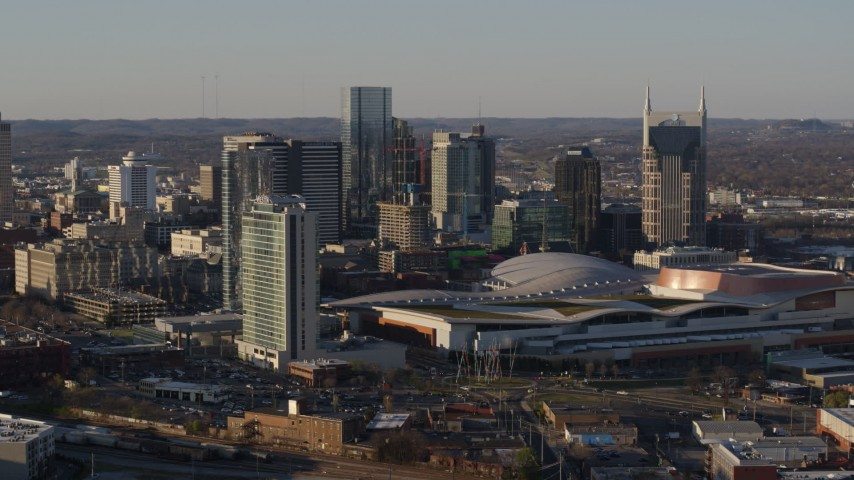 5.7K stock footage aerial video the city's tall skyline by the convention center in Downtown Nashville, Tennessee Aerial Stock Footage | DX0002_114_039