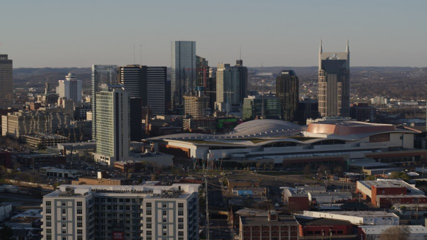 5.7K stock footage aerial video slow flight by city's tall skyline, Nashville Music City Center in Downtown Nashville, Tennessee Aerial Stock Footage | DX0002_114_041
