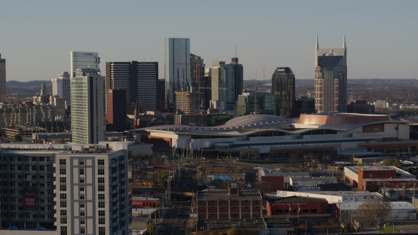 5.7K stock footage aerial video stationary view of city's tall skyline, Nashville Music City Center in Downtown Nashville, Tennessee Aerial Stock Footage | DX0002_114_042