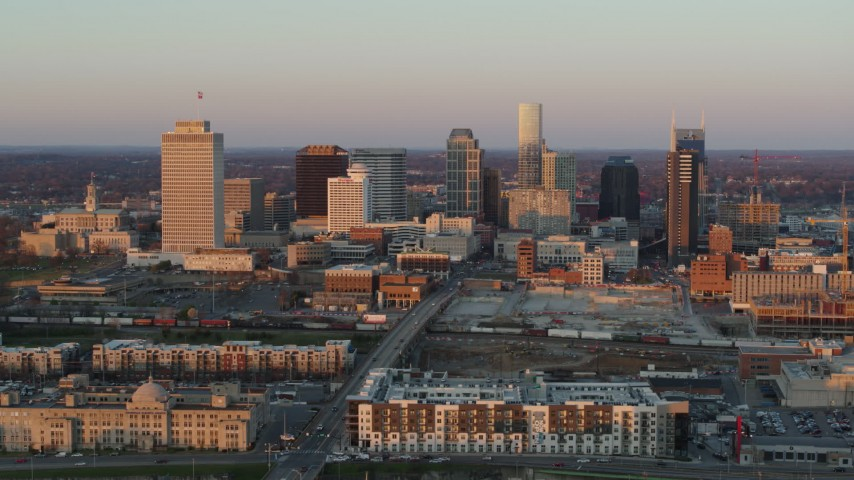 5.7K stock footage aerial video of the city's skyline at sunset before descending in Downtown Nashville, Tennessee Aerial Stock Footage | DX0002_115_001