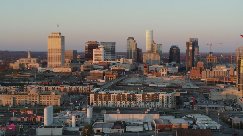 5.7K stock footage aerial video of flying by the city's skyline at sunset in Downtown Nashville, Tennessee Aerial Stock Footage | DX0002_115_002