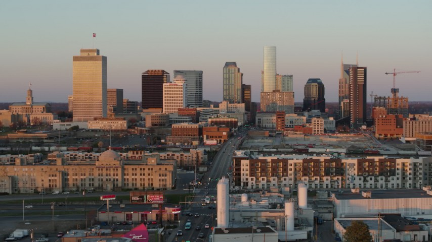 5.7K stock footage aerial video of a reverse view of the city's skyline at sunset in Downtown Nashville, Tennessee Aerial Stock Footage | DX0002_115_004