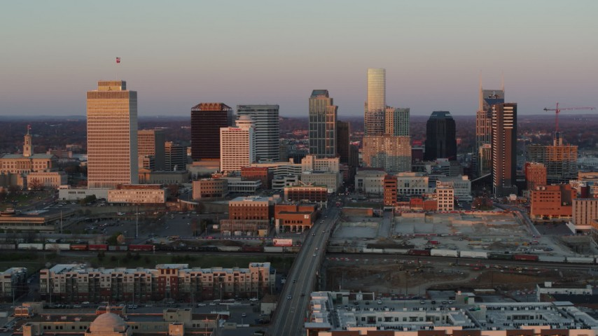 5.7K stock footage aerial video of a reverse view of the city's skyline at sunset during ascent in Downtown Nashville, Tennessee Aerial Stock Footage | DX0002_115_006