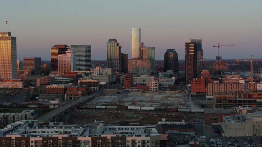 5.7K stock footage aerial video approach and flyby the city's skyline at sunset in Downtown Nashville, Tennessee Aerial Stock Footage | DX0002_115_010