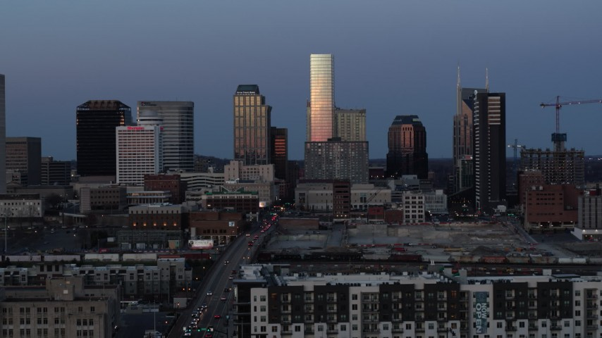 5.7K stock footage aerial video ascend with a view of the city's skyline at twilight in Downtown Nashville, Tennessee Aerial Stock Footage | DX0002_115_019