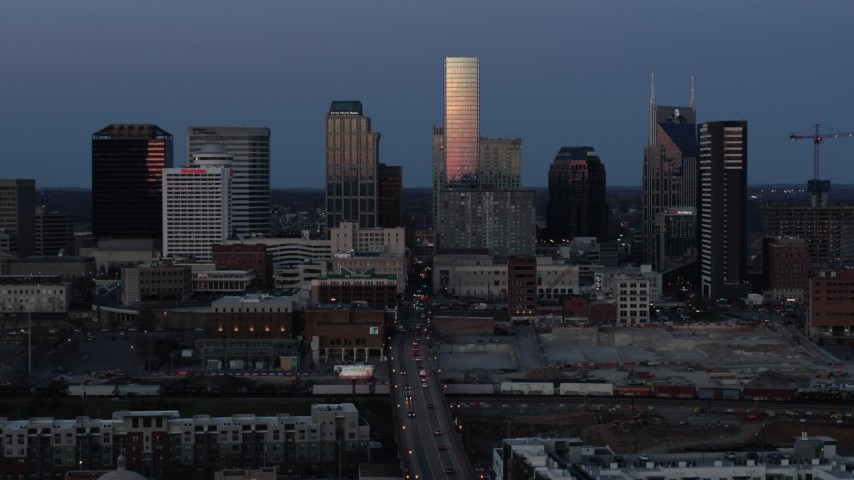 5.7K stock footage aerial video of passing by Church Street and the city's skyline at twilight in Downtown Nashville, Tennessee Aerial Stock Footage | DX0002_115_021