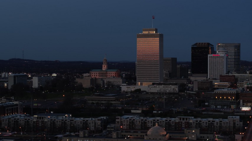 5.7K stock footage aerial video of the State Capitol and skyscraper at twilight in Downtown Nashville, Tennessee Aerial Stock Footage | DX0002_115_029