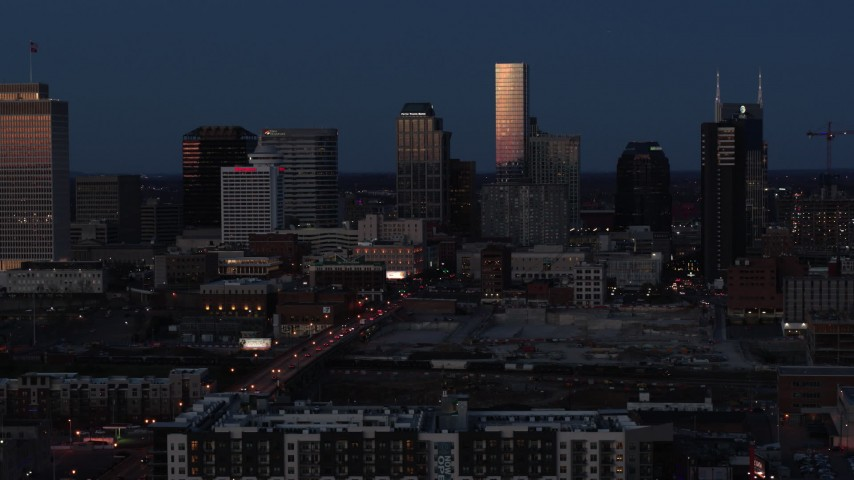 5.7K stock footage aerial video skyscrapers reflecting light in the city skyline at twilight in Downtown Nashville, Tennessee Aerial Stock Footage | DX0002_115_030