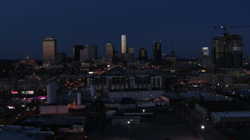5.7K stock footage aerial video wide view of skyscrapers reflecting light in the city skyline at twilight in Downtown Nashville, Tennessee Aerial Stock Footage | DX0002_115_032