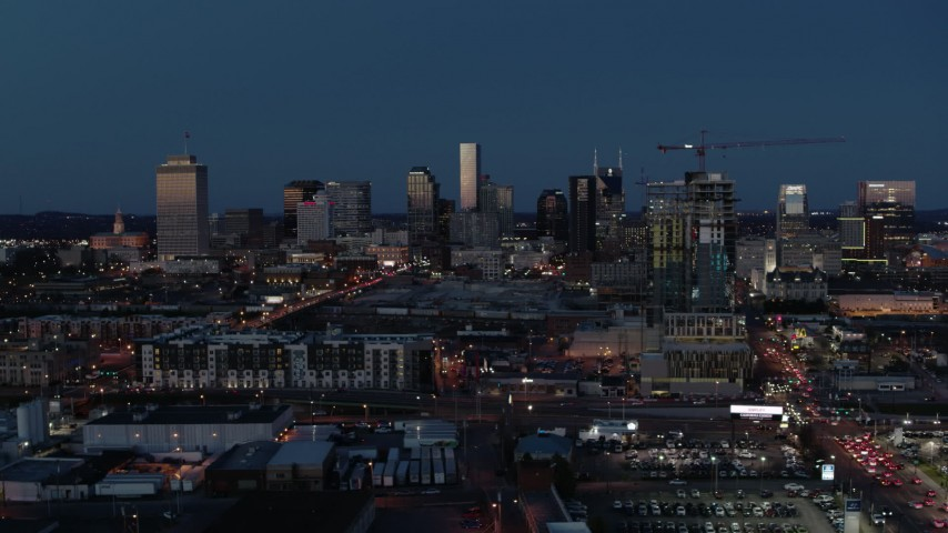 5.7K stock footage aerial video wide view of the city skyline and high-rise under construction at twilight, Downtown Nashville, Tennessee Aerial Stock Footage | DX0002_115_033