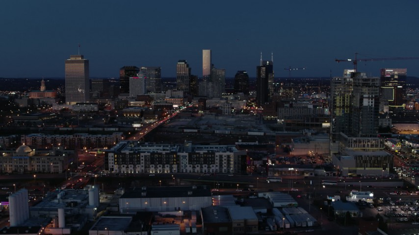 5.7K stock footage aerial video wide view of the city skyline, high-rise under construction at twilight, Downtown Nashville, Tennessee Aerial Stock Footage | DX0002_115_034