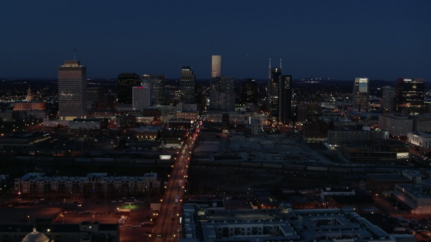 5.7K stock footage aerial video reverse view of Church Street and city skyline at twilight, Downtown Nashville, Tennessee Aerial Stock Footage | DX0002_115_036