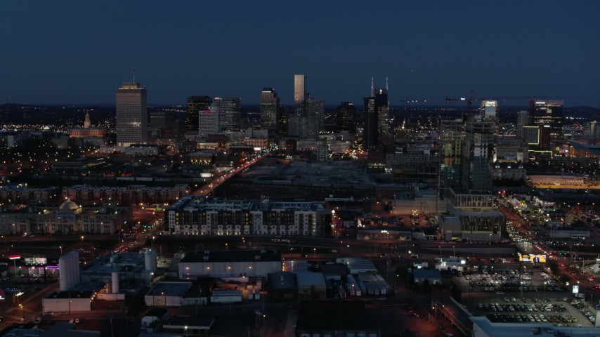 5.7K stock footage aerial video wide view of city skyline at twilight, near high-rise construction, Downtown Nashville, Tennessee Aerial Stock Footage | DX0002_115_038
