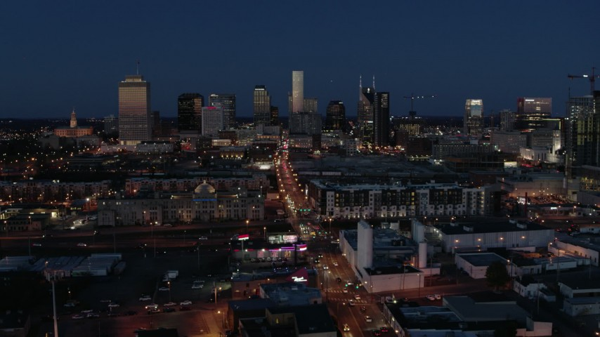 5.7K stock footage aerial video flashing lights and traffic on Church Street and city skyline, Downtown Nashville, Tennessee Aerial Stock Footage | DX0002_115_039