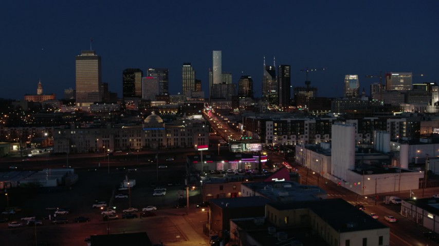 5.7K stock footage aerial video flashing lights and traffic on Church Street, city skyline, high-rise construction, Downtown Nashville, Tennessee Aerial Stock Footage | DX0002_115_040