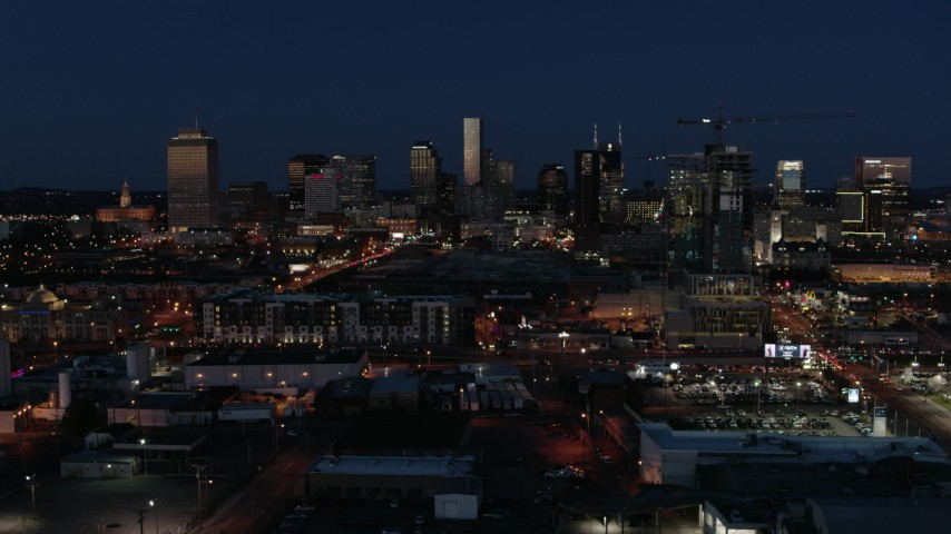 5.7K stock footage aerial video ascend and flyby the city skyline at twilight, Downtown Nashville, Tennessee Aerial Stock Footage | DX0002_115_041