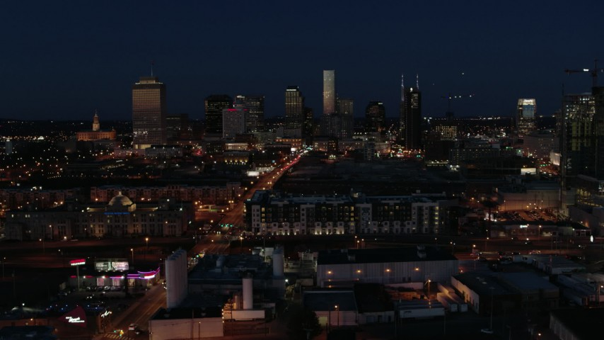 5.7K stock footage aerial video descend and fly away from the city skyline at twilight, Downtown Nashville, Tennessee Aerial Stock Footage | DX0002_115_044