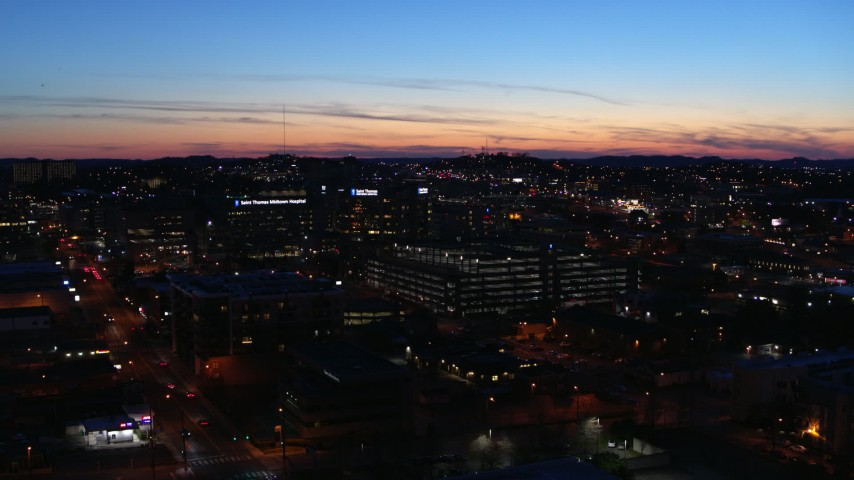 5.7K stock footage aerial video slowly orbit a hospital complex at twilight, Nashville, Tennessee Aerial Stock Footage | DX0002_115_045