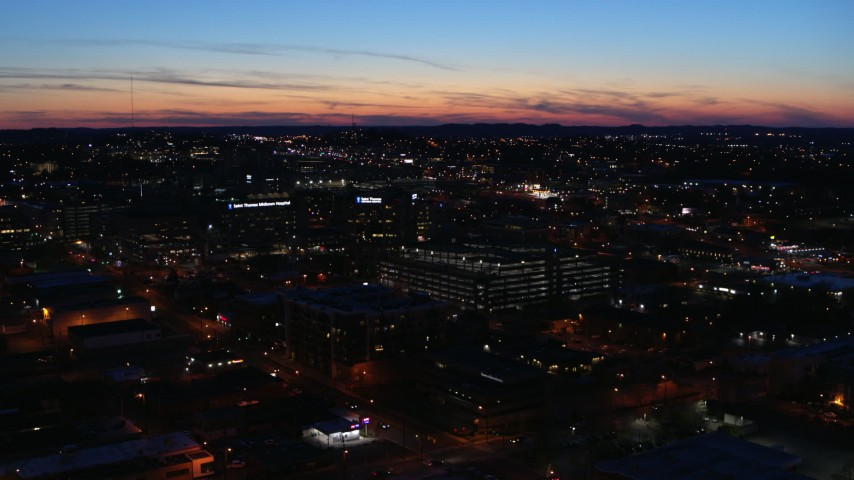 5.7K stock footage aerial video slowly circling a hospital complex at twilight while ascending, Nashville, Tennessee Aerial Stock Footage | DX0002_115_046