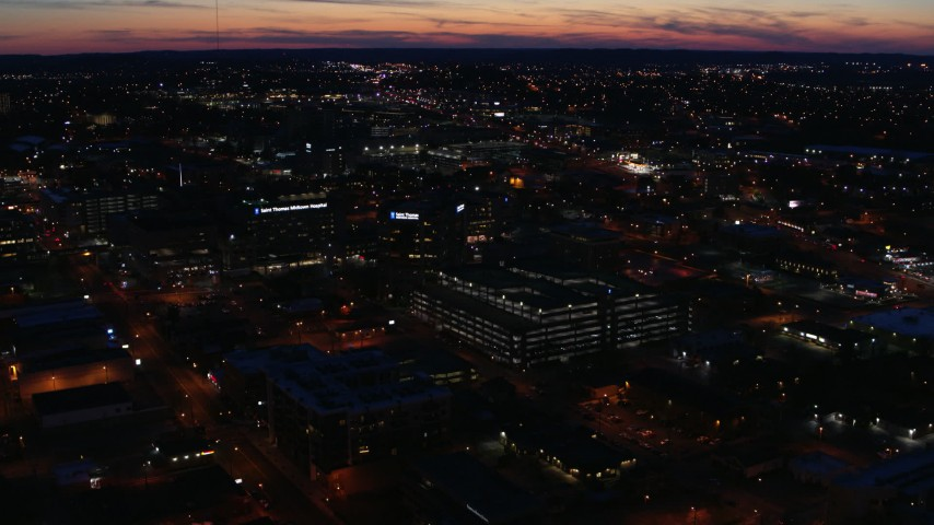 5.7K stock footage aerial video slowly orbit and approach a hospital complex at twilight, Nashville, Tennessee Aerial Stock Footage | DX0002_115_047