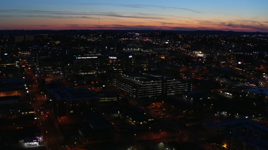 5.7K stock footage aerial video slowly flying away from a hospital complex at twilight, Nashville, Tennessee Aerial Stock Footage | DX0002_115_048
