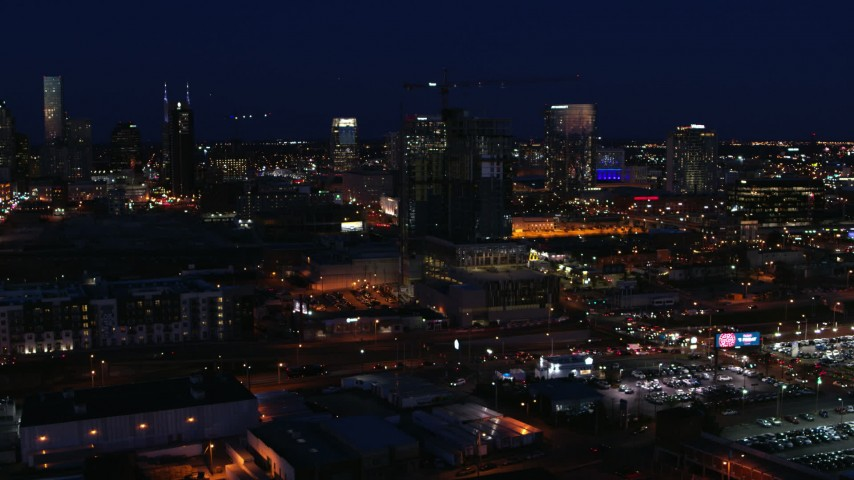 5.7K stock footage aerial video flyby a high-rise building under construction at night, Downtown Nashville, Tennessee Aerial Stock Footage | DX0002_115_049