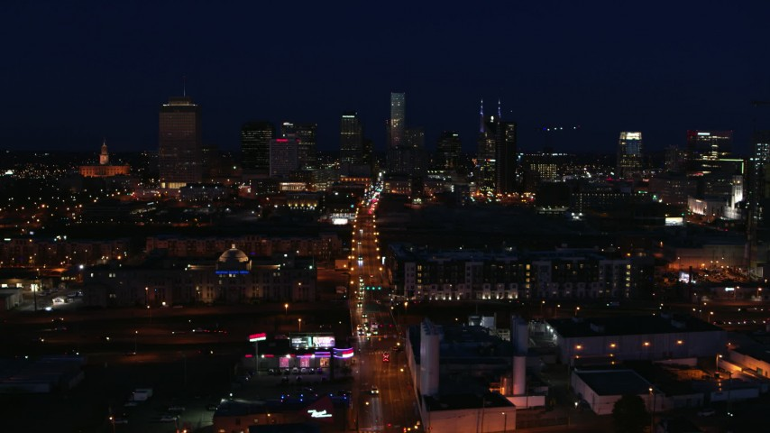 5.7K stock footage aerial video flying by Church Street and the city skyline at night, Downtown Nashville, Tennessee Aerial Stock Footage DX0002_115_050