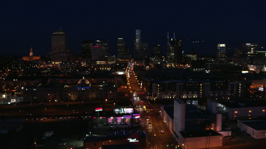 5.7K stock footage aerial video the city skyline at night while passing flashing lights on Church Street, Downtown Nashville, Tennessee Aerial Stock Footage | DX0002_115_053